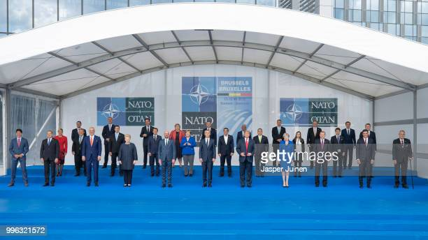 Heads of state and government pose for a family picture during the opening ceremony at the 2018 NATO Summit at NATO headquarters on July 11 2018 in...