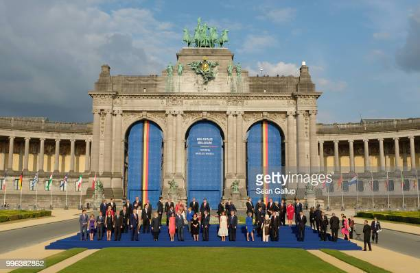 Heads of state and governments as well as their spouses gather for a group photo during the evening reception and dinner at the 2018 NATO Summit on...