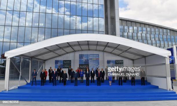 NATO heads of state and Prime Ministers pose for a family photograph during the NATO summit at the NATO headquarters in Brussels on July 11 2018