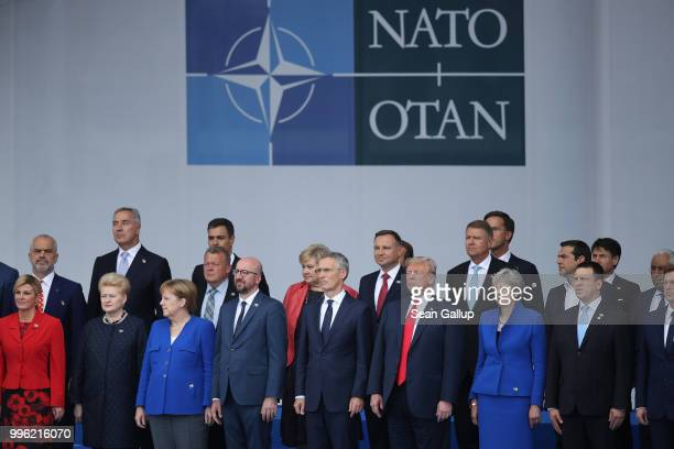 Heads of state including Croatian President Kolinda GrabarKitarovic Lithuanian President Dalia Grybauskaite German Chancellor Angela Merkel Belgian...