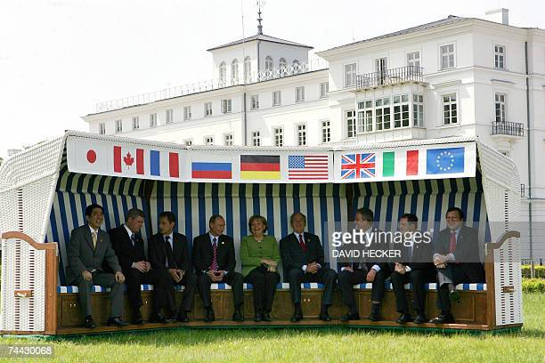 Heads of State pose in a giant beach chair for a family picture in front of the Kurhaus building in Heiligendamm, northeastern Germany, during their...