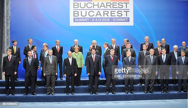 NATO heads of states and governments pose for a family picture at the Parliament Palace after the first formal working session on the second day of...