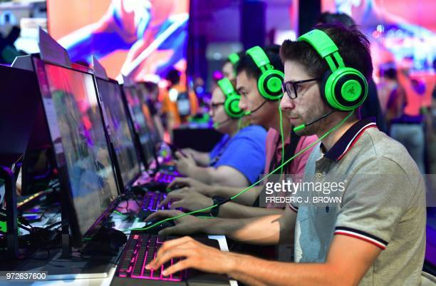 Headsets are worn to play the game Insurgency Sandstorm at the 24th Electronic Expo or E3 2018 in Los Angeles California on June 12 where hardware...