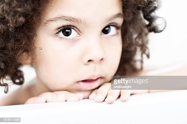Headshot 4 years old Girl in Bathroom Looking at Camera