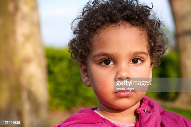 headshot of 2  years old child in the park - small faces stock pictures, royalty-free photos & images