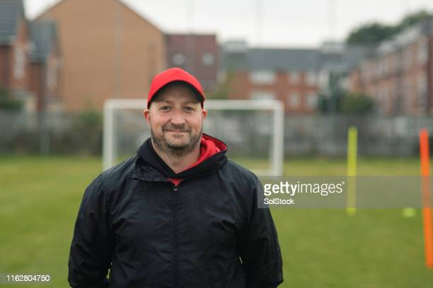 headshot of a male football coach - coach stock pictures, royalty-free photos & images