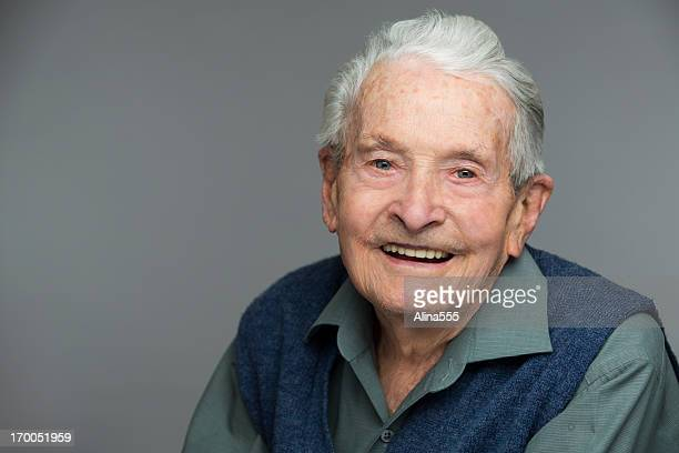 Headshot of a senior 90-year old man on grey