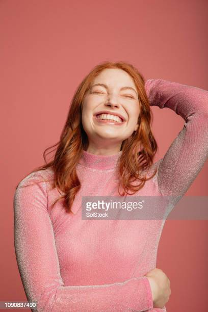 headshot of a smiling redhead - redhead stock pictures, royalty-free photos & images