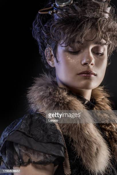 headshot of a steampunk female in a studio shot - historical clothing stock pictures, royalty-free photos & images