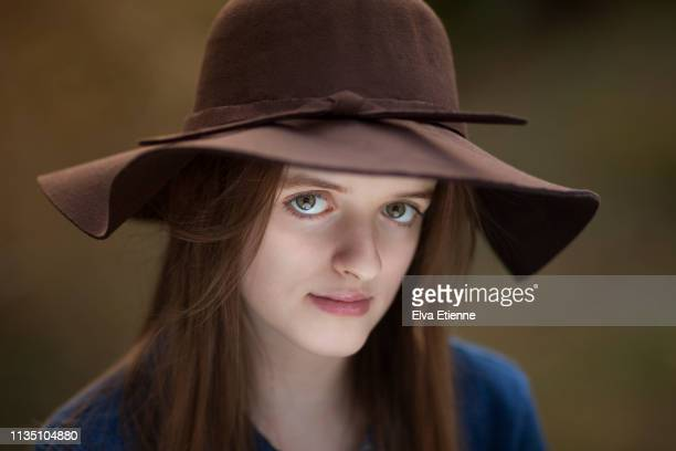 headshot of a teenage girl with neutral expression and eye contact - hazel eyes stock pictures, royalty-free photos & images