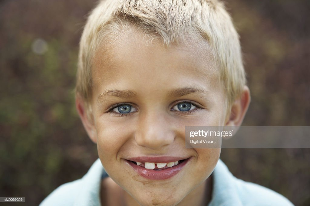 Headshot of a Young Boy With Gappy Teeth and a Messy Chin : Stock Photo