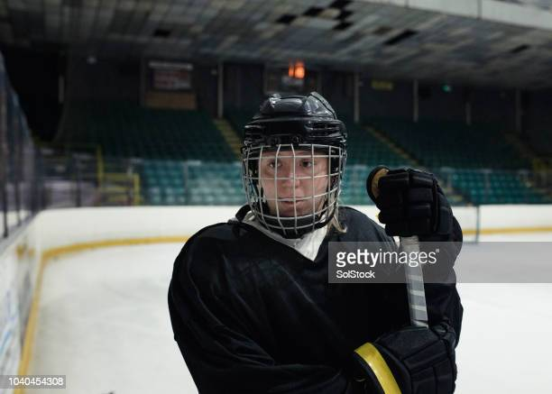 headshot of a young female ice hockey player - goalkeeper stock pictures, royalty-free photos & images