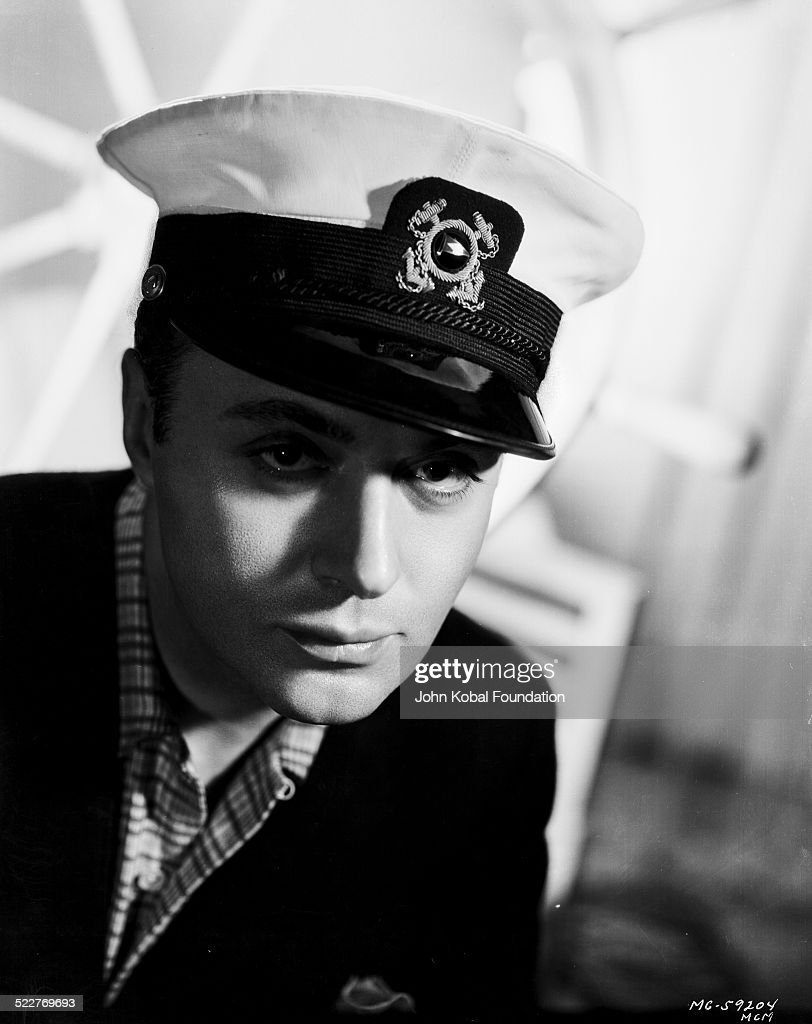 Headshot of actor Charles Boyer (1899-1978) wearing a sailor costume, for MGM Studios, 1937.