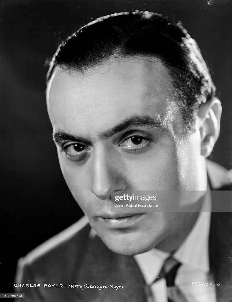 Headshot of actor Charles Boyer (1899-1978) wearing a suit and tie, for MGM Studios, 1931.