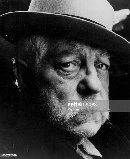 Headshot of actor Jean Gabin wearing a hat, as he appears in the movie 'The Dominici Affair', 1973.