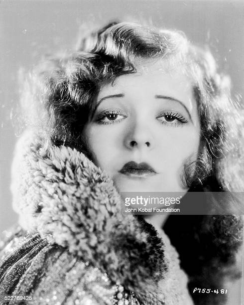 Headshot of actress Clara Bow wearing a fur coat for Paramount Pictures 1928