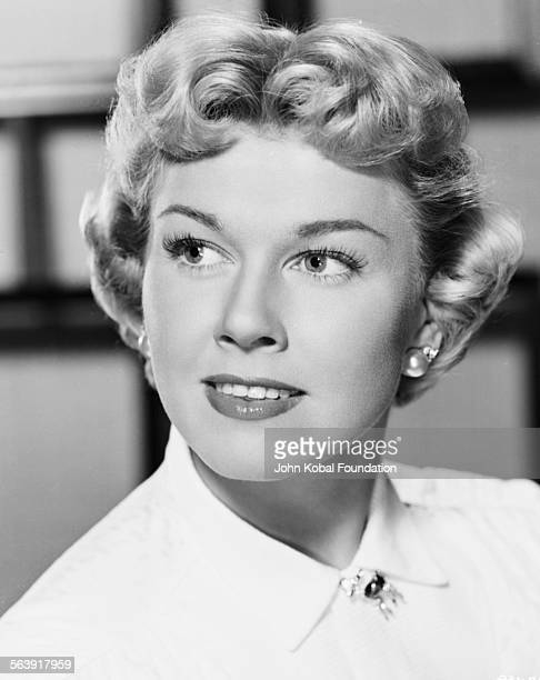 Headshot of actress Doris Day wearing a brooch at her neck for Warner Bros Studios 1951