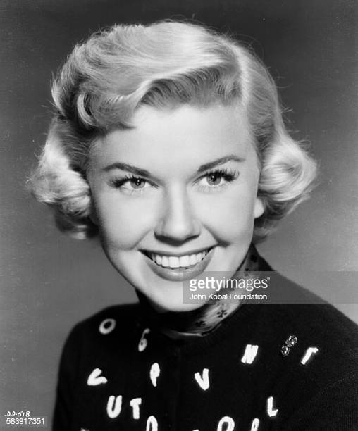 Headshot of actress Doris Day wearing an alphabet sweater for Warner Bros Studios 1951