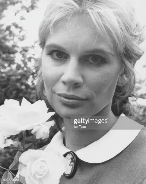 Headshot of actress Joanna Dunham in the garden of her home in London circa 1968