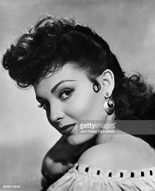 Headshot of actress Linda Darnell looking over her shoulder for 20th Century Fox circa 1950