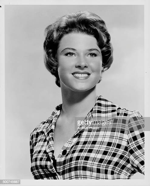 Headshot of actress Mariette Hartley wearing a gingham blouse as she appears in the movie 'Ride the High Country' 1962