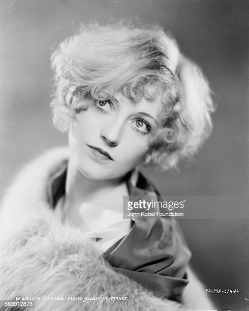 Headshot of actress Marion Davies draped in fur for MGM Studios October 2nd 1929