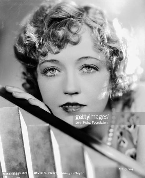 Headshot of actress Marion Davies wearing a pearl necklace for MGM Studios 1930