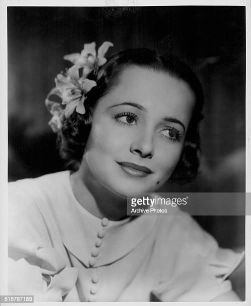 Headshot of actress Olivia de Havilland as she appears in the movie 'It's Love I'm After' 1937