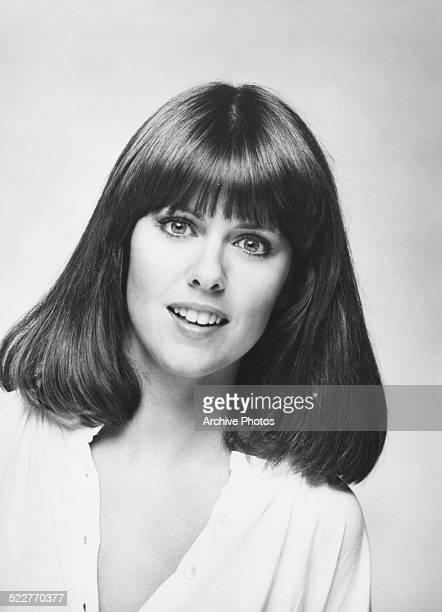 Headshot of actress Pam Dawber wearing an open necked shirt circa 1975