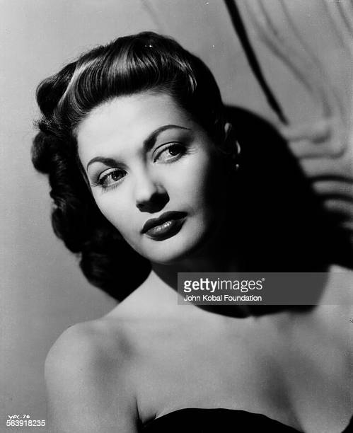 Headshot of actress Yvonne De Carlo wearing an off the shoulder dress for Universal Pictures 1945