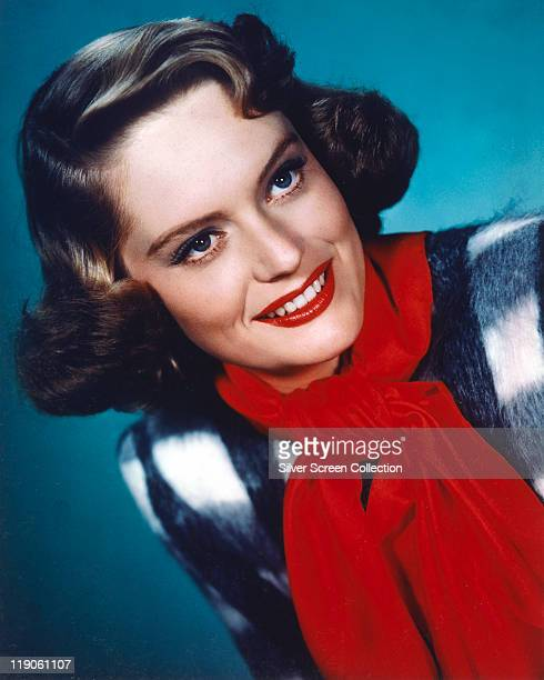 Headshot of Alexis Smith Canadian actress wearing a red scarf in a publicity still circa 1950