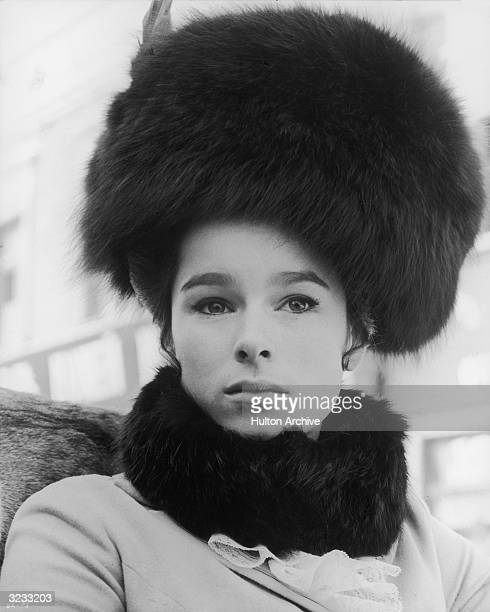 Headshot of American actor Geraldine Chaplin wearing a large fur hat and collar looking straight ahead in a scene from director David Lean's film...
