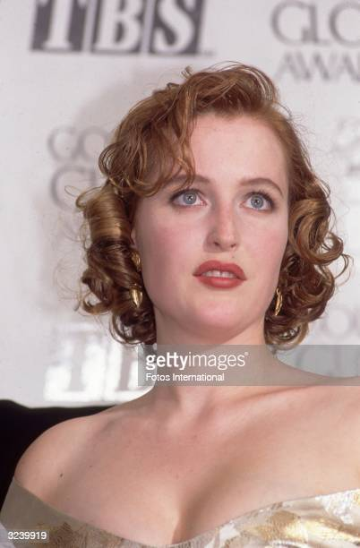Headshot of American actor Gillian Anderson standing on stage during the Golden Globes ceremony Los Angeles California She won Best Actress for her...
