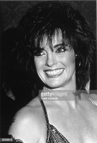 Headshot of American actor Linda Gray wearing a lowcut beaded dress smiling at the Century Plaza Hotel in Los Angeles California