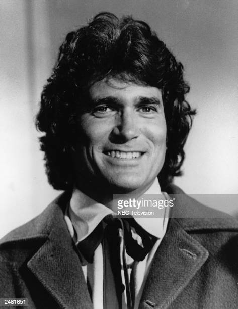Headshot of American actor Michael Landon smiling in costume from the television series 'The Little House On The Prairie'