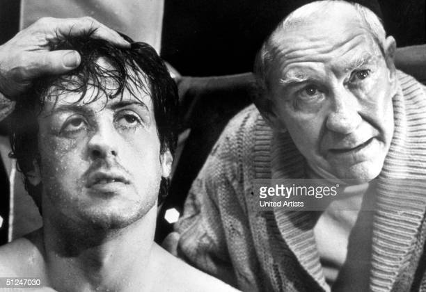 1976 Headshot of American actors Sylvester Stallone and Burgess Meredith in a still from the boxing film 'Rocky' directed by John Avildsen
