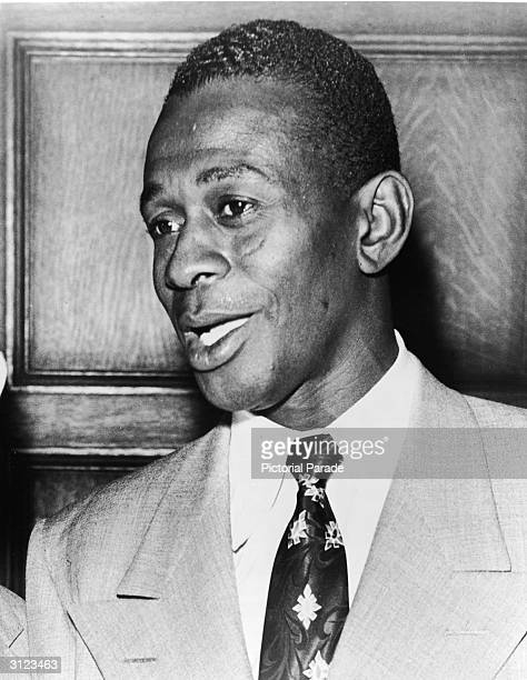 Headshot of American baseball player Leroy 'Satchel' Paige, wearing a suit during an award ceremony, 1940s.