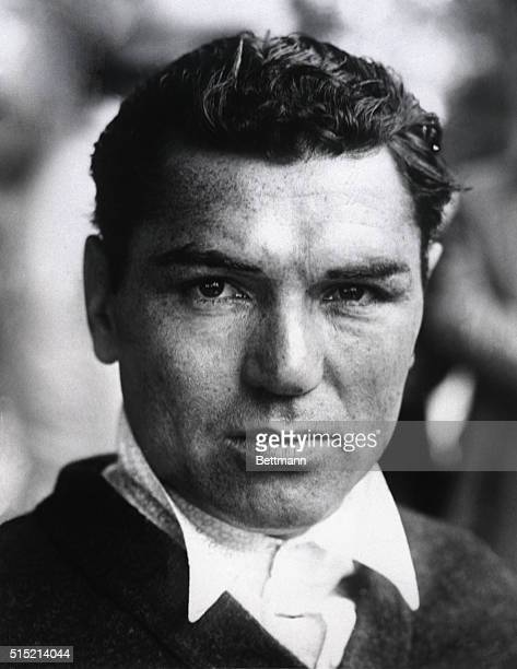 Headshot of American heavyweight boxing champion Jack Dempsey. Dempsey is shown here wearing a collared shirt and sweater. Undated photograph.