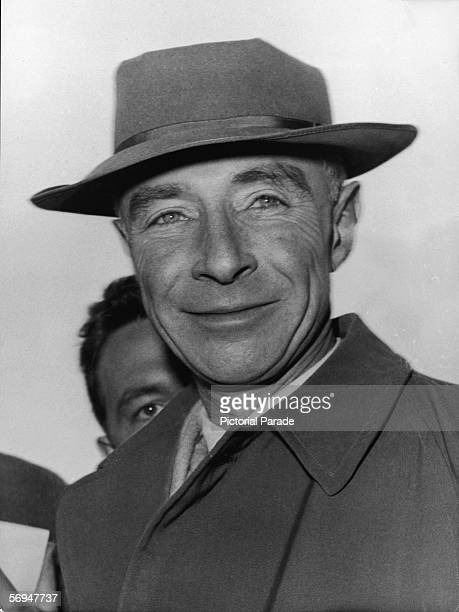 Headshot of American nuclear physicist and father of the atom bomb Robert Oppenheimer dressed in an overcoat and hat 1950s