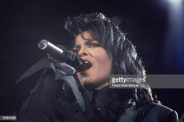Headshot of American pop and RB singer Janet Jackson singing on stage during a concert circa 1991