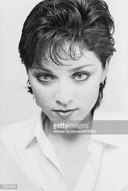 Headshot of American pop singer Madonna wearing an opennecked blouse with short dark hair New York City Spring 1979