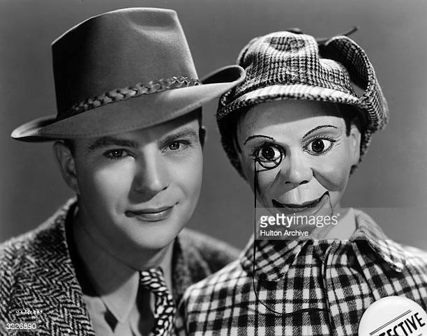 Headshot of American ventriloquist and comedian Edgar Bergen and his dummy Charlie McCarthy in a publicity portrait from director Frank Tuttle's film...