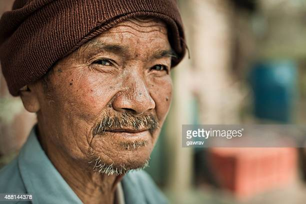 headshot of an asian senior man looking at camera. - nepalese ethnicity stock pictures, royalty-free photos & images