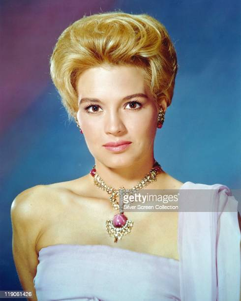 Headshot of Angie Dickinson US actress wearing a shoulderless gown and necklace with ornate pendant in a studio portrait circa 1960