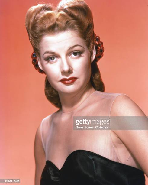 Headshot of Ann Sheridan US actress in a studio portrait against a pink background circa 1950