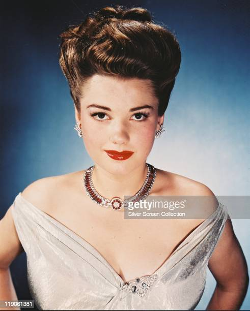 Headshot of Anne Baxter US actress wearing a shoulderless dress and necklace circa 1945