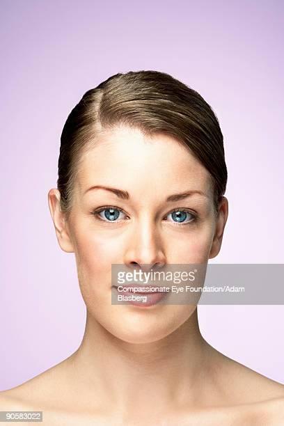 headshot of blue-eyed woman