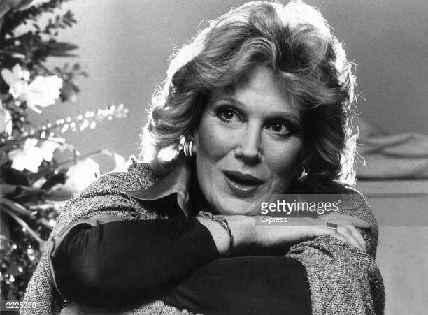 Headshot of British singer Dusty Springfield smiling while resting her chin on her arms She had just released her album 'It Begins Again'