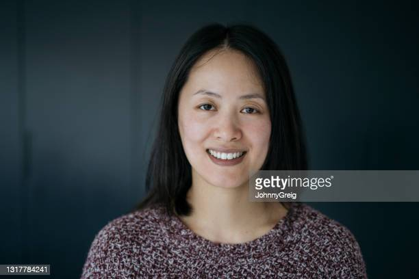 headshot of cheerful chinese woman in casual clothing - mid length hair stock pictures, royalty-free photos & images