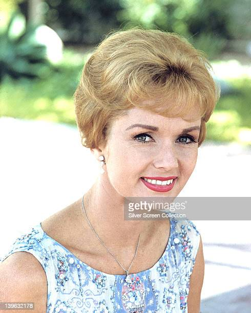 Headshot of Debbie Reynolds US actress singer and dancer wearing a blue and white print pattern sleeveless top circa 1970